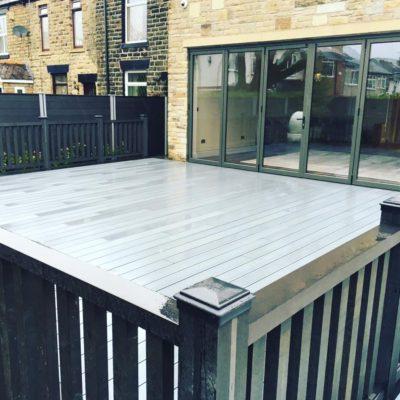 Grey Decking, balustrades and bi-fold door