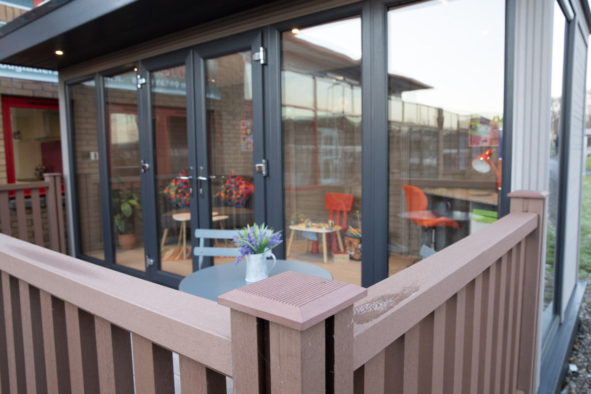 External shot of a McLeods Glaziers garden room with table and chairs